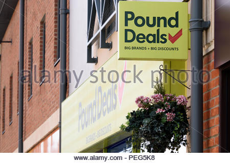 Looking up at the Pound Deals signs and logos above the store in Didcot, Oxfordshire, England, UK - Stock Photo