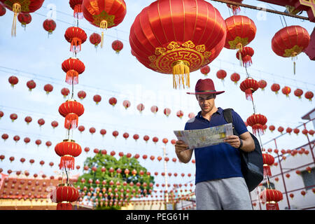 Traveler on asian city street. Daylight shooting. - Stock Photo
