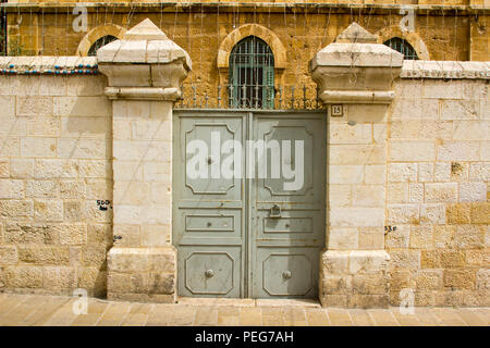 10 May 2018 A double doored steel gate into a property in the Arab Quarter of the Old Walled City of Jerusalem Israelwall - Stock Photo