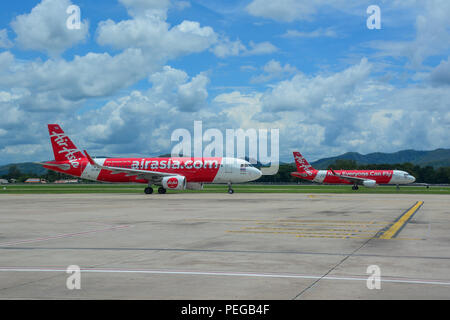 Chiang Mai, Thailand - Jun 22, 2016. Airbus A320 airplanes of AirAsia taxiing on runway of Chiang Mai Airport (CNX). - Stock Photo
