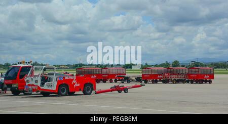 Chiang Mai, Thailand - Jun 22, 2016. Vehicles running on runway of Chiang Mai Airport (CNX). - Stock Photo