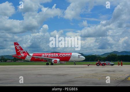 Chiang Mai, Thailand - Jun 22, 2016. An Airbus A320 airplane of AirAsia taxiing on runway of Chiang Mai Airport (CNX). - Stock Photo