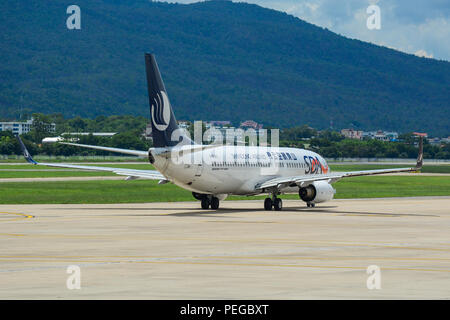 Chiang Mai, Thailand - Jun 22, 2016. A Boeing 737 airplane of Shandong Airlines taxiing on runway of Chiang Mai Airport (CNX). - Stock Photo
