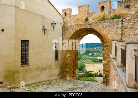 St. Martin gate in the old town of Magliano in Toscana, Italy - Stock Photo