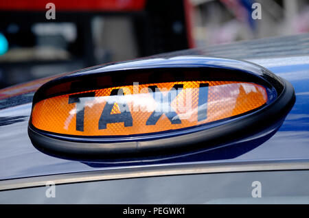 taxi sign on london black cab, england - Stock Photo