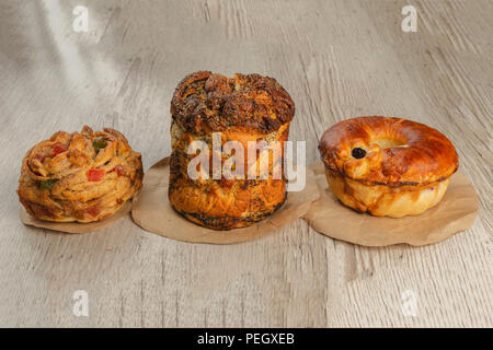 Three different pies on a wooden background. - Stock Photo
