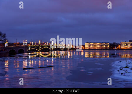 View of Trinity Bridge over Neva River at night in the beginning of winter. Saint Petersburg, Russia - Stock Photo
