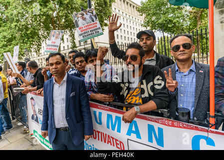 August 13, 2018 - London, UK. 13th August 2018. A protest opposite Downing St by the Bangladeshi Nationalist Party UK called for the release of their party leader, Begum Khaleda Zia, jailed in February for five years for embezzlement of international funds donated to Zia Orphanage Trust. The charge was first made around ten years ago, and the BNP claim is politically motivated. Her elder son Tarique Rahman was sentenced to 10 years in jail but is still in London. Khaleda Zia was the First Lady of Bangladesh during the presidency of her husband Ziaur Rahman who founded the Bangladesh Nationalis - Stock Photo