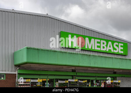 Poole, UK. 15th August 2018. The dirty sign of the Tower Park Homebase store - one of the 42 set to close in the near future. Hilco, which bought the DIY chain for £1 in May, confirmed it was planning a Company Voluntary Arrangement (CVA). Credit: Thomas Faull/Alamy Live News - Stock Photo