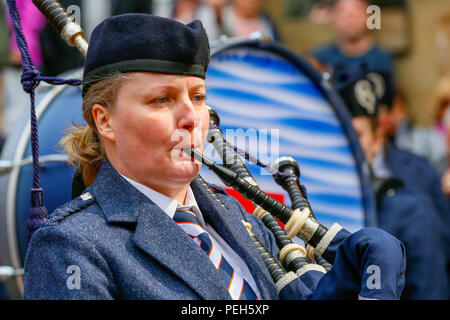 Glasgow, UK. 15th Aug 2018. Street performances continue in Buchanan Street, Glasgow with more international pipe bands playing near the Donald Dewar statue to entertain the public for free. The Pipe Band championships conclude on Saturday 18th August at Glasgow Green. Members of the Simon Fraser University Pipe Band from British Columbia, Canada Credit: Findlay/Alamy Live News - Stock Photo
