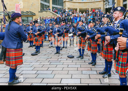Glasgow, UK. 15th Aug 2018. Street performances continue in Buchanan Street, Glasgow with more international pipebands playing near the Donald Dewar statue to entertain the public for free. The Pipe Band championships conclude on Saturday 18th August at Glassgow Green. Members of the Simon Fraser University Pipe Band from British Columbia, Canada Credit: Findlay/Alamy Live News - Stock Photo