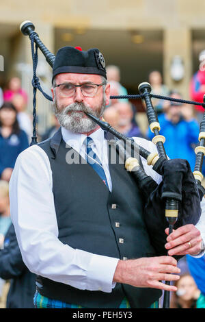 Glasgow, UK. 15th Aug 2018. Street performances continue in Buchanan Street, Glasgow with more international pipe bands playing near the Donald Dewar statue to entertain the public for free. The Pipe Band championships conclude on Saturday 18th August at Glasgow Green. Picture of ALLAN CLEARWATER from Christchurch playing with the New Zealand Pipe Band of Christchurch, New Zealand Credit: Findlay/Alamy Live News - Stock Photo