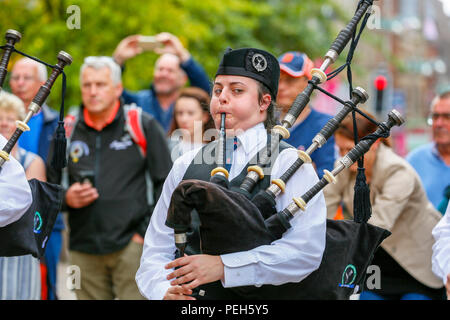 Glasgow, UK. 15th Aug 2018. Street performances continue in Buchanan Street, Glasgow with more international pipe bands playing near the Donald Dewar statue to entertain the public for free. The Pipe Band championships conclude on Saturday 18th August at Glasgow Green Credit: Findlay/Alamy Live News - Stock Photo