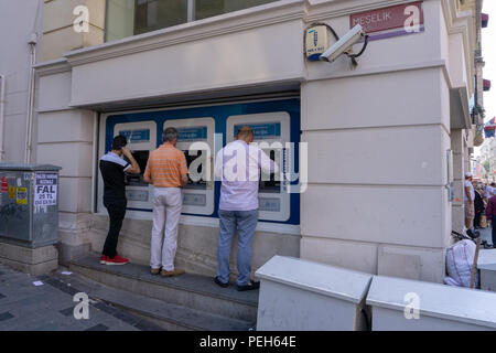 Istanbul, Turkey. 15th August 2018. Bank ATMs are also used for exchange Credit: Engin Karaman/Alamy Live News - Stock Photo