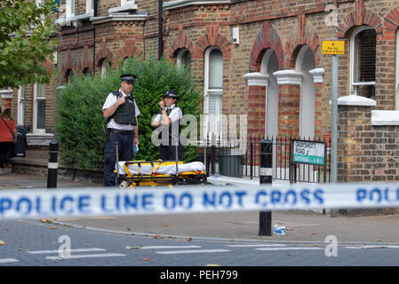 London, United Kingdom. 15 August 2018. A murder investigation has been launched in Wandsworth after a woman was fatally stabbed. Police were called on Wednesday, 15 August at 12:38BST to a report of a stabbing at a residential address in Grayshott Road, SW11. A woman, believed to be aged in her 30s was found with a stab injury. She was pronounced dead at the scene at 13:41BST. Credit: Peter Manning/Alamy Live News - Stock Photo