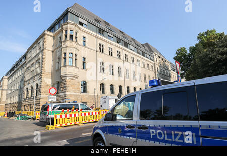 16 August 2018, Germany, Leipzig: Police secure the district court before a trial concerning a particularly serious breach of the peace begins. More than two and a half years after the riots of neo-Nazis in Leipzig's Connewitz district, the first defendants face their trial. During the riots on 11 January 2016, the windows of numerous shops were smashed and cars set on fire. Connewitz is considered a stronghold for leftist and autonomous groups. Credit: dpa picture alliance/Alamy Live News - Stock Photo