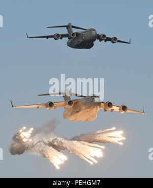 C-17 Globemaster self defence flare demonstration by Qatar Emiri Air Force during practice Display for the Qatar National Day celebrations in Doha - Stock Photo