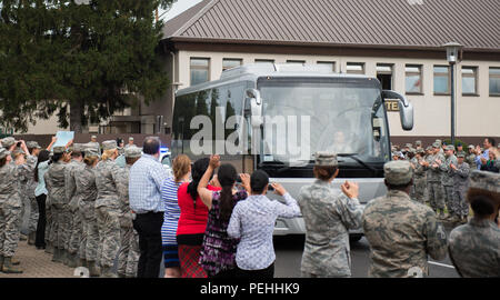 Oregon National Guardsman Aleksander Skarlatos is greeted upon is arrival to Ramstein Air Base, Germany, Aug. 24, 2015. More than 200 Airmen and their families came out to line the streets and thank Skarlatos and Airman 1st Class Spencer Stone for their bravery. They arrived at Ramstein while in transit to Landstuhl Regional Medical Center for follow-on medical treatment. Stone received multiple injuries, all of which were non-life threatening, while subduing an armed gunman on a train traveling from Amsterdam to Paris. Stone is an ambulance service technician with the 65th Medical Operations  - Stock Photo