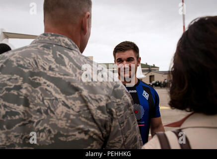 Oregon National Guardsman Aleksander Skarlatos meets Brig. Gen. Jon T. Thomas, 86th Airlift Wing commander, as he arrives at Ramstein Air Base, Germany, Aug. 24. 2015. Skarlatos, along with childhood friends Airman 1st Class Spencer Stone and Anthony Sadler, was recently honored by French President François Hollande with the French Legion of Honour for subduing an armed gunman when he entered their train carrying an assault rifle, a handgun and a box cutter. (U.S. Air Force Photo/Staff Sgt. Sara Keller) - Stock Photo