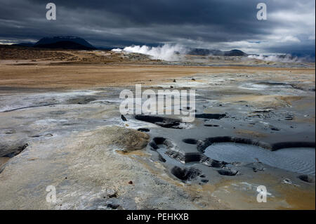 Hot pools and steaming fumeroles  in midsummer at Hverarond or Namaskard, a volcanic area adjacent to Route 1 near Lake Myvatn, Iceland - Stock Photo