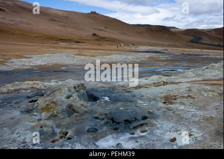 Blackened earth and  empty steam holes at Hverarond or Namaskard, a volcanic area adjacent to Route 1 near Lake Myvatn, Iceland in summertime - Stock Photo