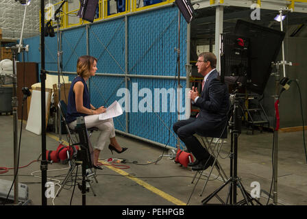 Secretary of Defense Ash Carter is interviewed by Emily Chang from Bloomberg West  during a visit to Moffett Field, Calif., Aug. 28, 2015. Carter visited the Defense Innovation Unit - Experimental and spoke at the Manufacturing Innovation Institute event at the National Full Scale Aerodynamics Complex at Moffett Field. (Photo by Master Sgt. Adrian Cadiz) - Stock Photo