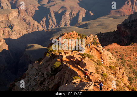 AZ00278-00...ARIZONA - Early morning hikers on the South Kaibab Trail in Grand Canyon National Park. - Stock Photo