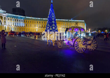 Saint Petersburg, Russia - January 3, 2018: Horse drawn carriage for tourists on Palace square at night - Stock Photo
