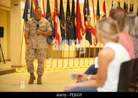 U.S. Marine Corps Lt. Col. Theodore C. Bethea II (left), Commanding Officer, Advanced Infantry Training Battalion (AITB), School of Infantry-East (SOI-E), addresses guests during the AITB Post and Relief aboard Camp Geiger, N.C., Aug. 4, 2015. Staff of SOI-E and family members attended the AITB Post and Relief Ceremony where Sgt. Maj. Garza relinquished his post to Sgt. Maj. Baiotto. (U.S. Marine Corps by SSgt Mark E. Morrow Jr, Combat Camera, SOI-E/ Released) - Stock Photo