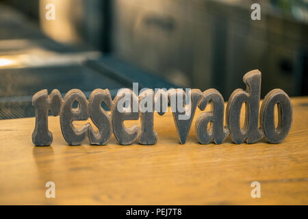reserved plate on the table in a restaurant - Stock Photo