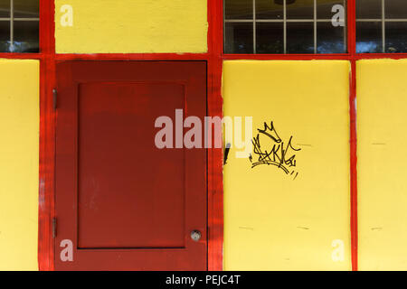 Colorful facade of old wooden building in Japantown, Vancouver, BC, Canada - Stock Photo