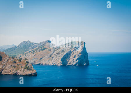 The imposing cliffs of Formentor cap in Majorca overlooking the Mediterranean Sea - Stock Photo