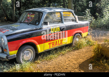 Thale, Saxony-Anhalt, Germany, July 12, 2018: Old dirty ugly Trabant with black-red-gold paint as advertisement for the GDR Museum Thale. - Stock Photo