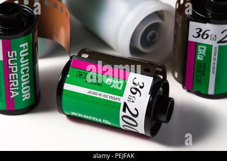 Rolls of Fujifilm Superia 200 35mm colour negative roll film in canisters - Stock Photo