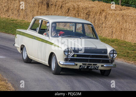 1965 Ford-Lotus Consul Cortina Mk1 BSCC car with driver Stuart Clark at the 2018 Goodwood Festival of Speed, Sussex, UK. - Stock Photo