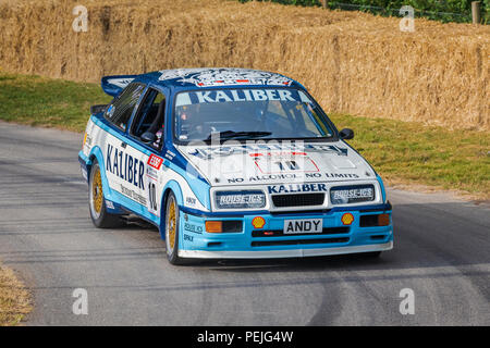 1989 Ford Sierra Cosworth RS500, originally driven by Andy Rouse, here driven by Calum Lockie at the 2018 Goodwood Festival of Speed, Sussex, UK. - Stock Photo