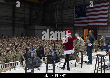 Actress Elizabeth Banks and Comedian David Wain host a USO show at Bagram Air Base, Afghanistan, Dec. 8, 2015. USO entertainers are traveling to various locations to visit service members who are deployed from home during the holidays. (DoD photo by D. Myles Cullen/Released) - Stock Photo
