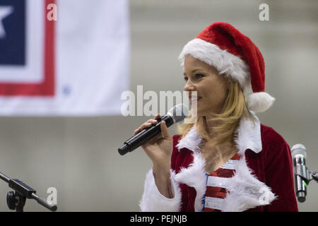 Actress Elizabeth Banks host a USO show at Bagram Air Base, Afghanistan, Dec. 8, 2015. USO entertainers are traveling to various locations to visit service members who are deployed from home during the holidays. (DoD photo by D. Myles Cullen/Released) - Stock Photo