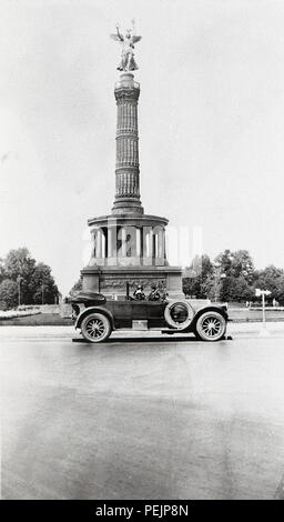 Germany Berlin The Victory Column is a monument in Berlin, Germany. Designed by Heinrich Strack, after 1864 to commemorate the Prussian victory in the Danish-Prussian War  A Pierce Arrow car in front of monument taken 1928  1920s - Stock Photo