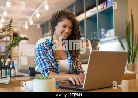 Freelancer woman working using  laptop and drink coffee  at cafe shop . - Stock Photo