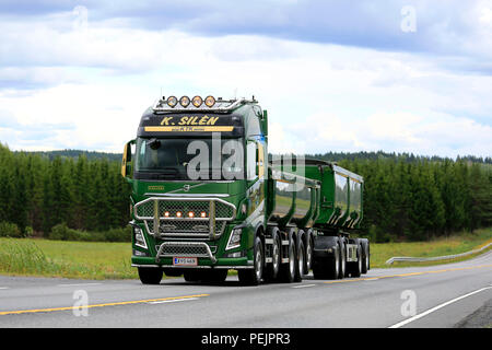 IKAALINEN, FINLAND - AUGUST 12, 2018: Customized green Volvo FH16 750 of K. Silen on road returning from Power Truck Show 2018. - Stock Photo