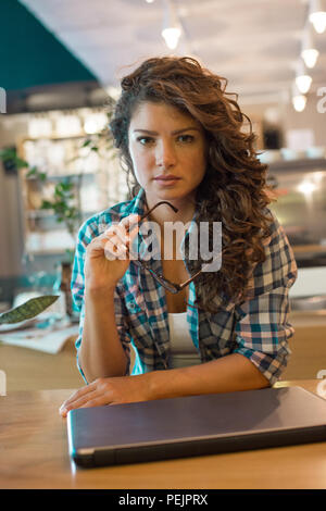 Beautiful brunette female with serious expression.Businesswoman - Stock Photo