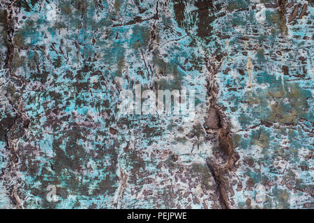 Aged copper plate texture with green patina stains. Old worn metal background. - Stock Photo
