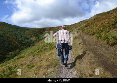 Walker in the Shropshire Hills, from Carding Mill Valley to the Long Mynd. England, UK - Stock Photo
