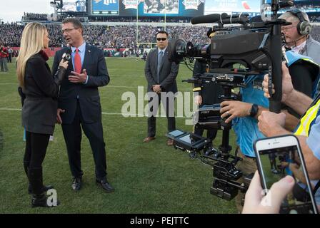 Secretary of Defense Ash Carter is interviewed by a CBS reporter prior to the 2015 Army Navy game in Philadelphia, Dec 12, 2015. (DoD photo by Mass Communication Specialist 1st Class Tim D. Godbee)(Released) - Stock Photo