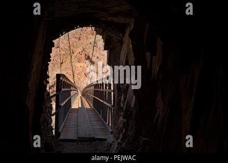 AZ00288-00...ARIZONA - Tunnel through a rock wall leading to the Black Bridge over the Colorado River on the South Kaibab Trail in Grand Canyon Nation - Stock Photo