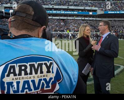 Secretary of Defense Ash Carter is interviewed by a CBS reporter prior to the 2015 Army Navy Game in Philadelphia, Dec. 12, 2015. (DoD photo by Mass Communication Specialist 1st Class Tim D. Godbee/Released) - Stock Photo