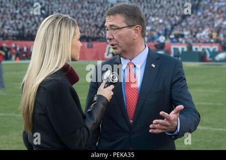 Secretary of Defense Ash Carter is interviewed by a CBS reporter at the 2015 Army Navy Game in Philadelphia, Dec. 12, 2015.  (DoD photo by Mass Communication Specialist 1st Class Tim D. Godbee/Released) - Stock Photo