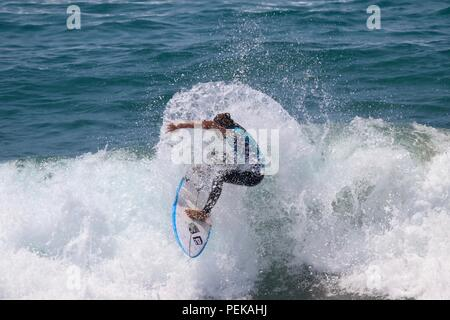 Keely Andrew competing in the US Open of Surfing 2018 - Stock Photo
