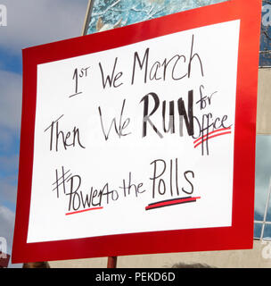 Asheville, North Carolina, USA – January 20, 2018: Close up of a colorful sign held up high in the 2018 Women's March that says '1st We March, Then We - Stock Photo